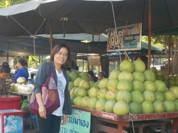 Nan with giant pomelo that tastes like grapefruit.
